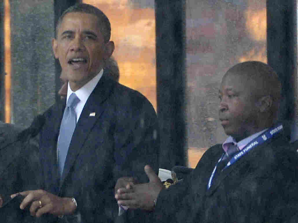 As President Obama and other world leaders spoke Tuesday in Johannesburg at a memorial for Nelson Mandela, a man stood nearby and appeared to be doing sign language interpretation. Many in the deaf community are outraged because the man appeared to be faking.