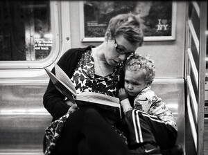 Original caption via Instagram: #pscommute 5:15 PM on the C Train. 34th Street, Penn Station back home to Fort Greene, Brooklyn. Giving the gift of reading. A magical moment between mother and son. It may seem like just another subway ride, but with a book and an imagination, the adventures are limitless.