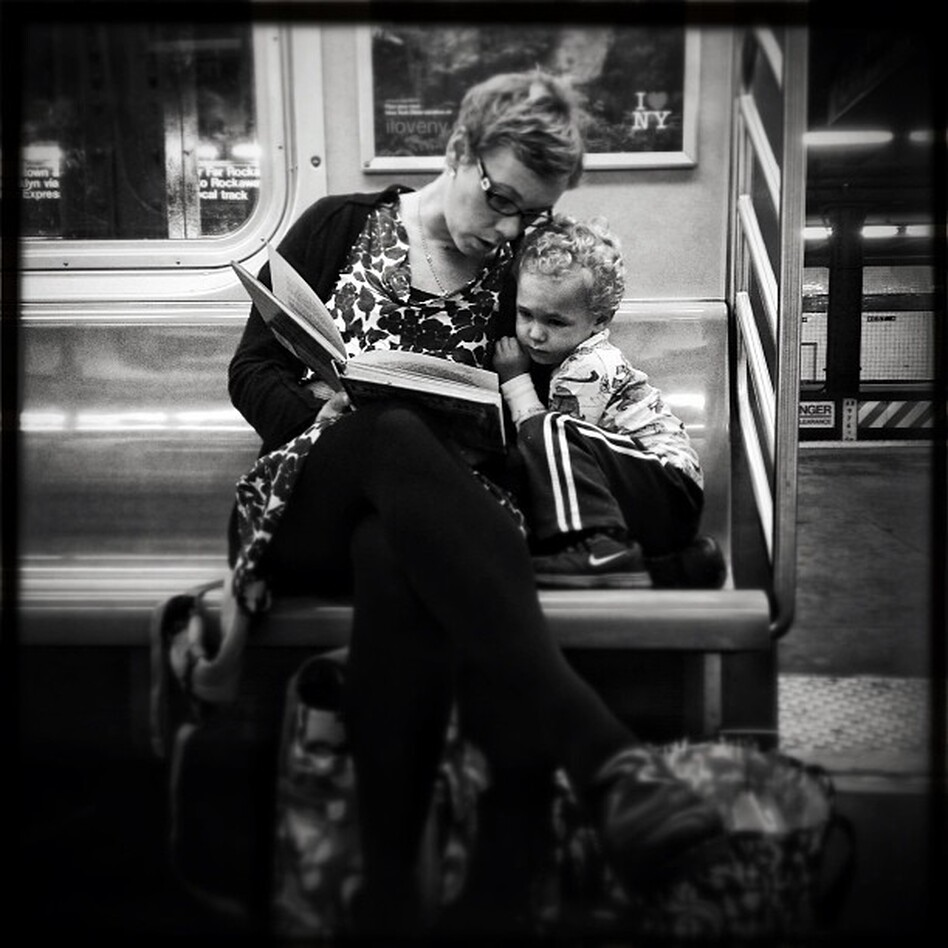 <strong>Original caption via Instagram:</strong> #pscommute 5:15 PM on the C Train. 34th Street, Penn Station back home to Fort Greene, Brooklyn. Giving the gift of reading. A magical moment between mother and son. It may seem like just another subway ride, but with a book and an imagination, the adventures are limitless. (Jabali Sawicki/@jsawicki1/Instagram)