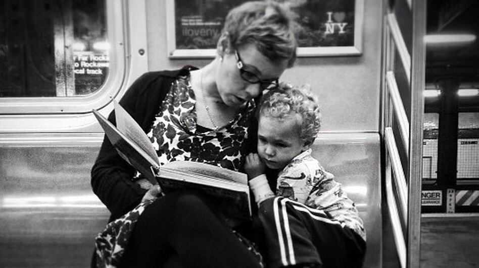 <strong>Original caption via Instagram:</strong> #pscommute 5:15 PM on the C Train. 34th Street, Penn Station back home to Fort Greene, Brooklyn. Giving the gift of reading. A magical moment between mother and son. It may seem like just another subway ride, but with a book and an imagination, the adventures are limitless.