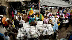 Bales of imported clothing are wheeled into the Gikombo Market in Nairobi, Kenya.