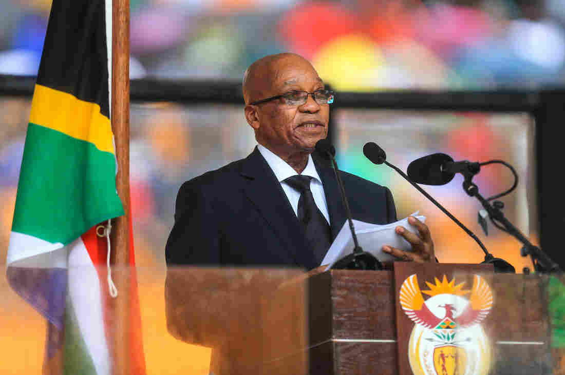 South African President Jacob Zuma addresses the memorial service for Nelson Mandela in Johannesburg, South Africa, on Tuesday. The audience at the service began booing Zuma from the moment he stepped into the stadium.