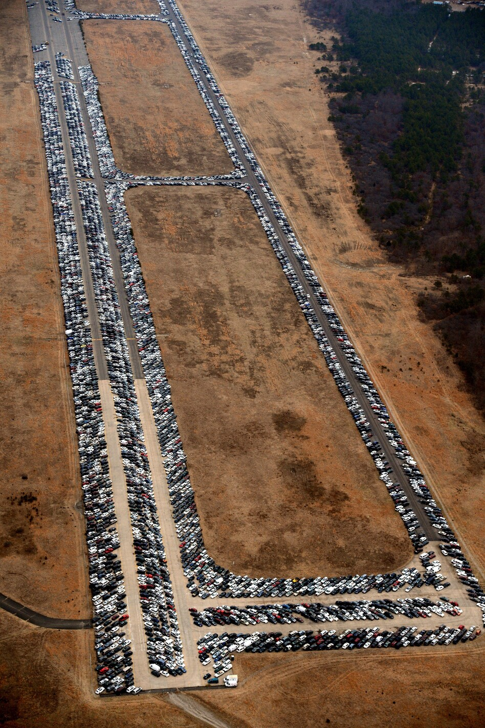 Cars line the runway and taxiways at Calverton Executive Airpark in Calverton, N.Y., on Jan. 9.
