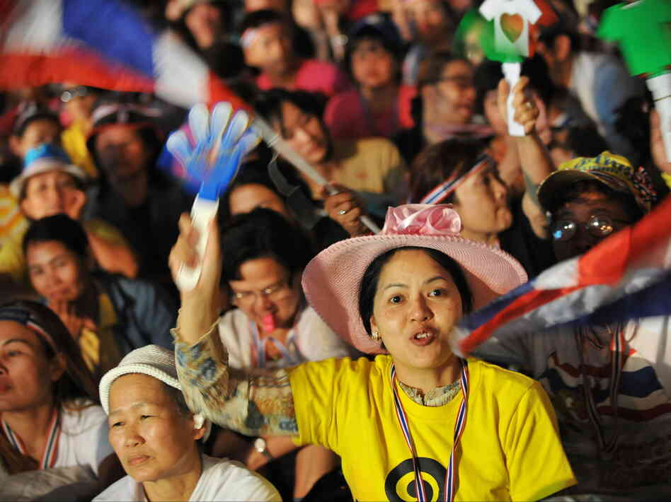 Anti-government protesters react to a speech by former Democrat Party MP and anti-government protest leader Suthep Thaugsuban during a large rally near Government House on Tuesday in Bangkok.