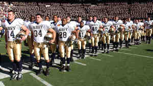 Navy players await the start of their annual game against Army, on Dec. 1, 2001.