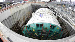 In this photo made with a fish-eye wide-angle lens, Bertha, the massive boring machine that is drilling a two-mile tunnel under Seattle, is shown in July before work began. The tunnel will replace a double deck highway along the downtown Seattle waterfront.