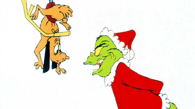 The Grinch puts a scare into his dog, Max, in the 1966 CBS special How The Grinch Stole Christmas.