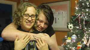 Rheanna Kathleen Morris hugs her mom, Peggy Sinclair-Morris.