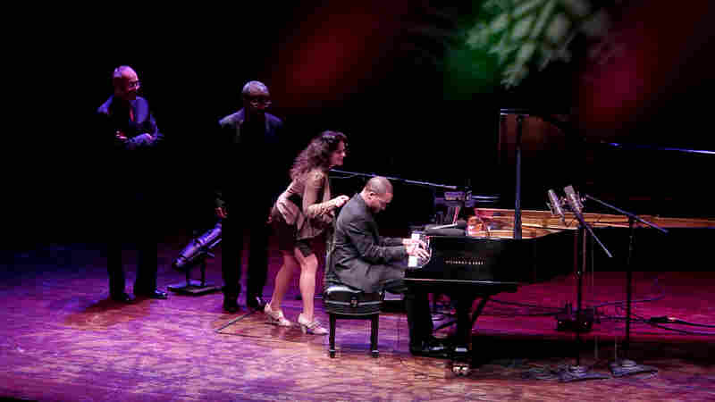 "Left to right: Stanley Cowell, Andy Bey, Michele Rosewoman and Sullivan Fortner team up on ""Jingle Bells"" during A Jazz Piano Christmas."