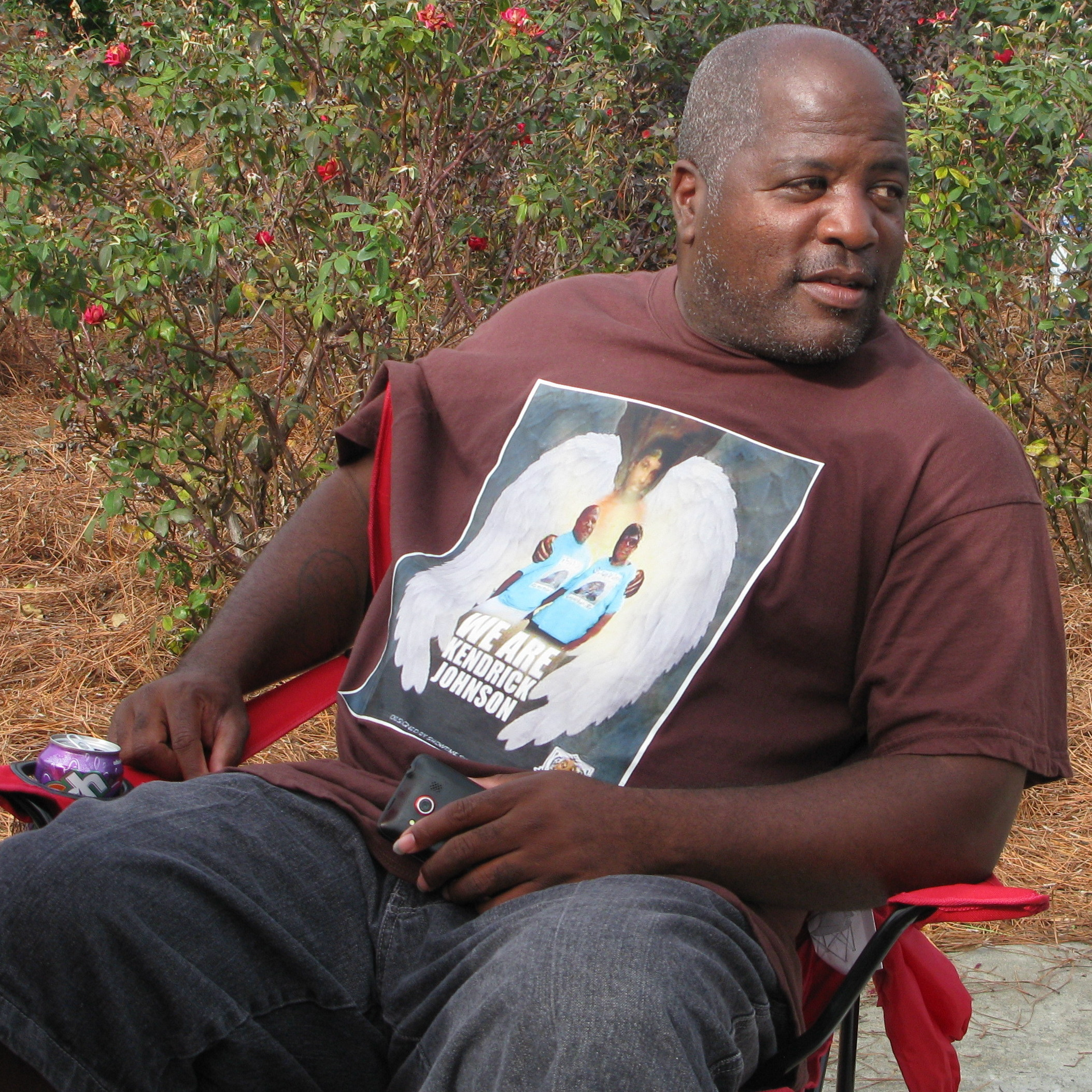 Kenneth Johnson wears a shirt with an image of his son Kendrick, 17, in November. Johnson and other family members have maintained a presence near the Lowndes County judicial complex in Valdosta, Ga., since last January after Kendrick's body was discovered in a gym mat at his high school.