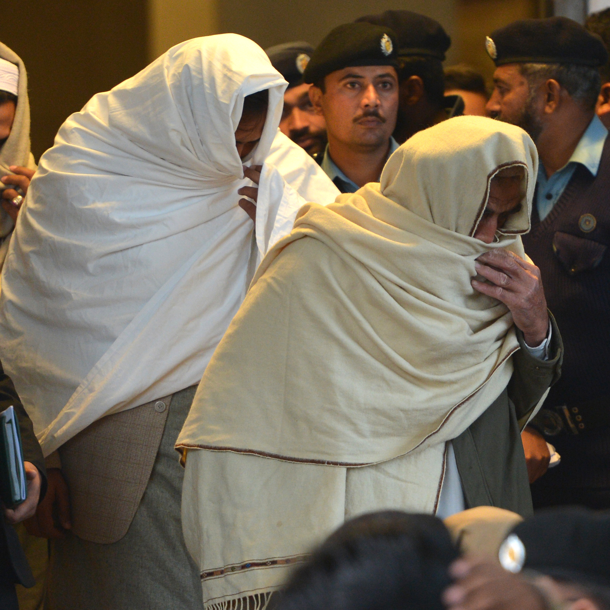 "Pakistani policemen escort newly identified missing persons -- people who ""disappeared"" after being taken away by the country's powerful security agencies -- as they leave the Supreme Court building in Islamabad on Dec. 7."