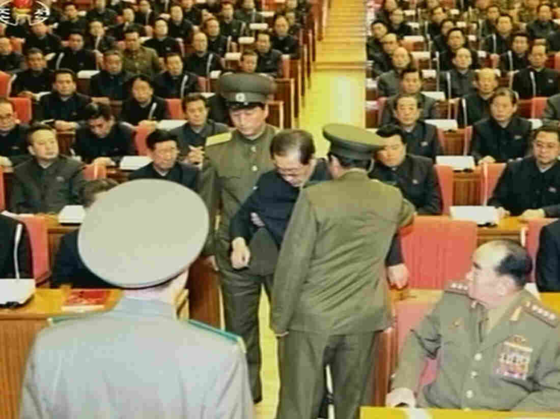 A still image taken from North Korea's state-run television footage and released Monday shows Jang Song Thaek being forcibly removed by uniformed personnel from a meeting of the Central Committee of the Workers' Party of Korea in Pyongyang.