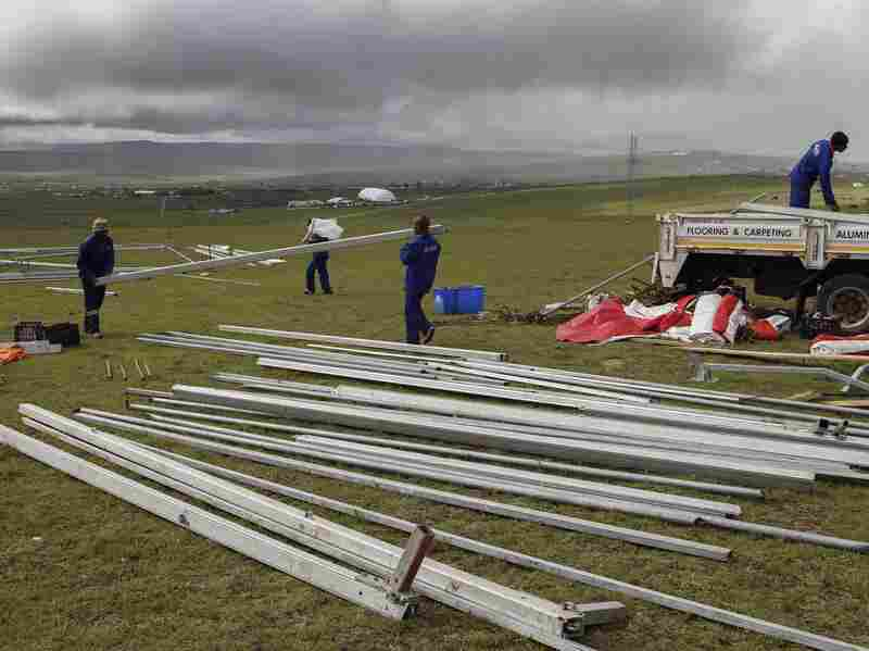 South African workers construct a giant LCD screen and marquee as a public viewing area above Mandela's home in Qunu on Thursday.