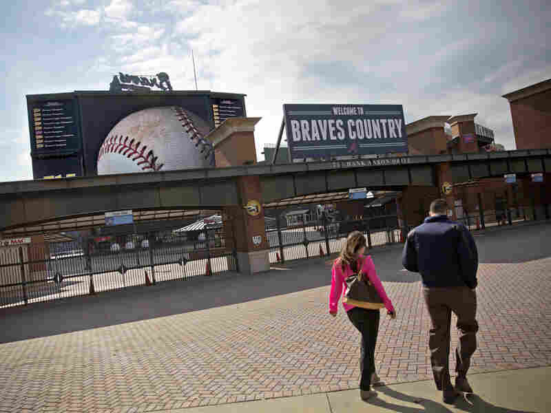 Employees enter Turner Field, the home of the Atlanta Braves baseball team.