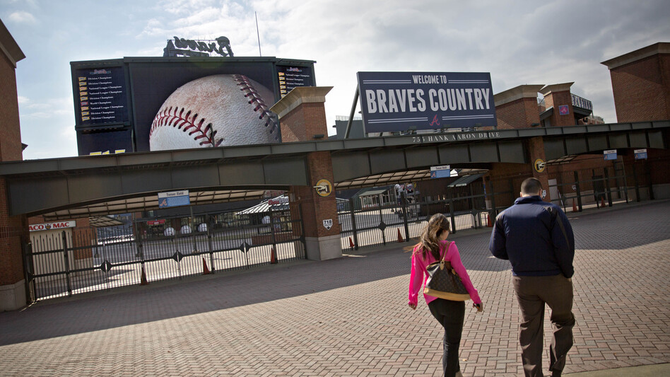 Employees enter Turner Field, the home of the Atlanta Braves baseball team.