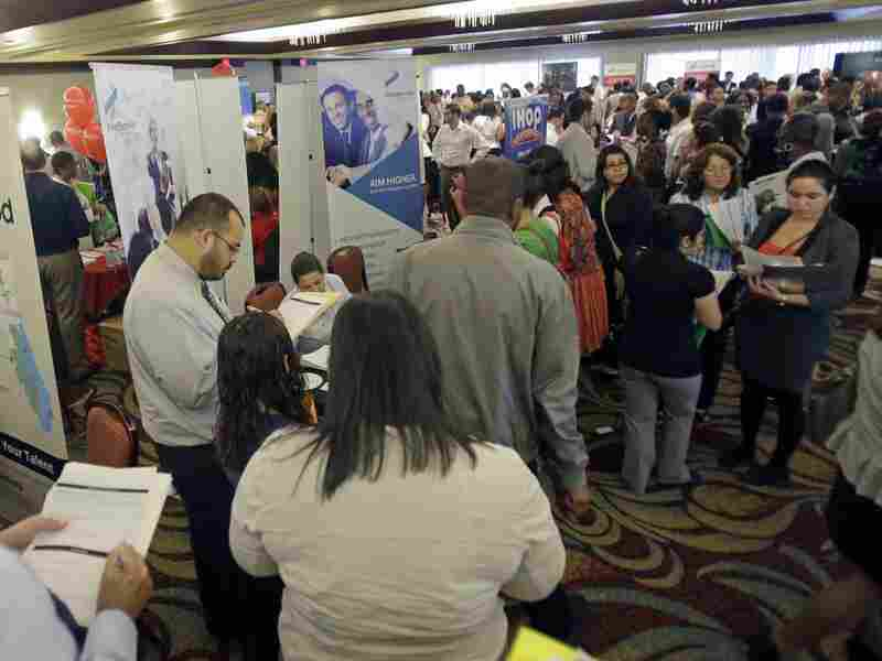 Job seekers attend at a career fair in Miami Lakes, Fla., in August. At the end of the year, 1.3 million Americans will lose their extended unemployment benefits.