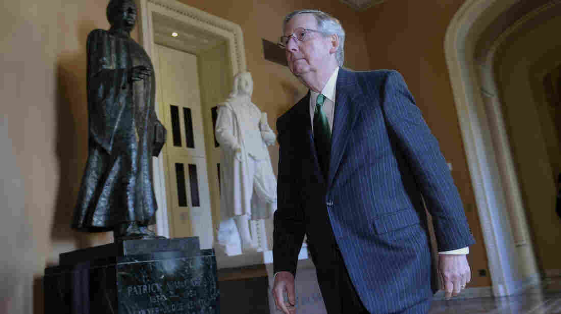 Senate Minority Leader Mitch McConnell of Kentucky heads to the Senate floor to vote on Friday.
