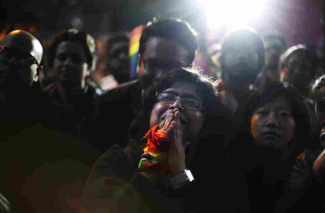 In New Delhi, India, a gay rights activist cries amid a protest against the Indian Supreme Court's decision to reinstate a ban on gay sex.