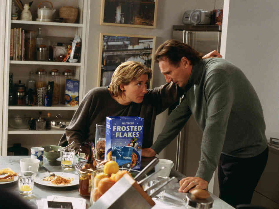 Karen (Emma Thompson) tries to console Daniel (Liam Neeson), whose wife h