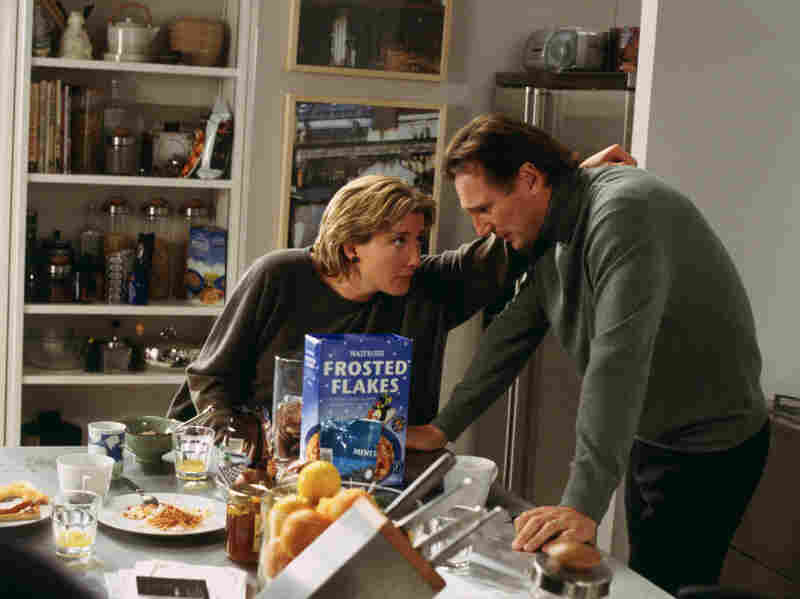 Karen (Emma Thompson) tries to console Daniel (Liam Neeson), whose wife has recently died.