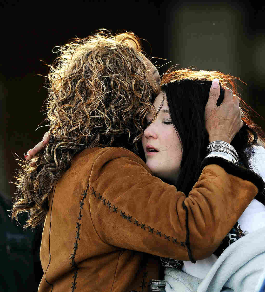 A woman hugs a student at Shepherd of the Hills Church near Arapahoe High School after a school shooting on Friday in Centennial, Colorado.