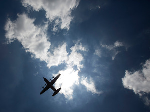 A military aircraft carrying the body of former South African President Nelson Mandela departs from Waterkloof military airbase for the Eastern Cape on Saturday in Pretoria, South Africa.