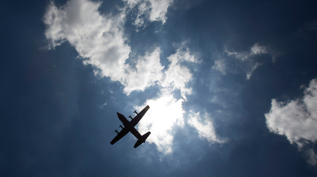 A military aircraft carrying the body of former South African President Nelson Mandela departs from Waterkloof military airbase for the Eastern Cape on Saturday in Pretoria, South Africa. (Getty Images)