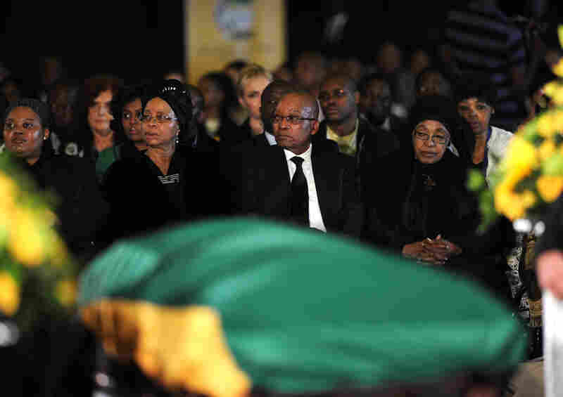 South African President Jacob Zuma, widow of late South African President Nelson Mandela, Graca Machel and Mandela's ex-wife Winnie Mandela Madikizela, right, attend a Farewell Service on Saturday at the Waterkloof air force base in Pretoria.