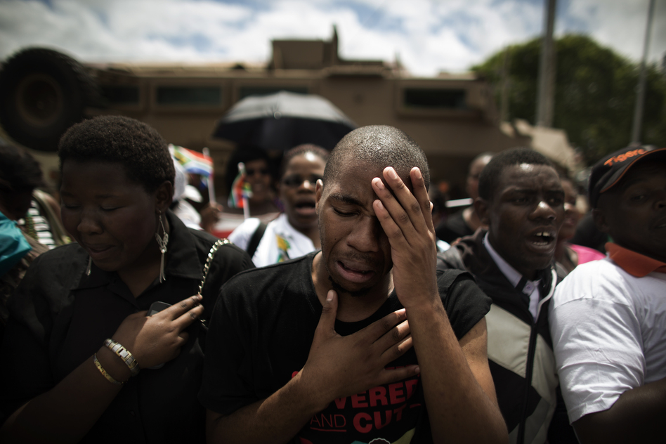 South Africans react after the hearse carrying Mandela's coffin drives by in Mthatha on Saturday. Mandela will embark on the final leg of his exceptional 95-year journey on Saturday, when his remains are returned to his rural childhood home in Qunu for traditional burial.