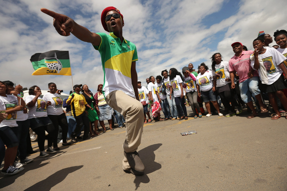 A man dances and sings while waiting for Mandela's funeral cortege in Mthatha, South Africa.