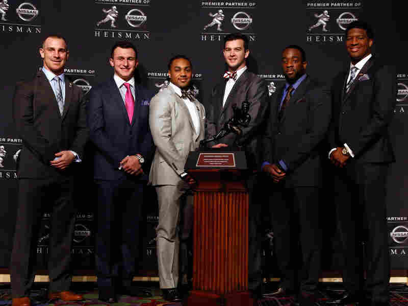 The Heisman Trophy finalists pose with the award Saturday. From left are Northern Illinois quarterback Jordan Lynch, Texas A&M quarterback Johnny Manziel, Auburn running back Tre Mason, Alabama quarterback AJ McCarron, Boston College quarterback Andre Williams and Florida State quarterback Jameis Winston.