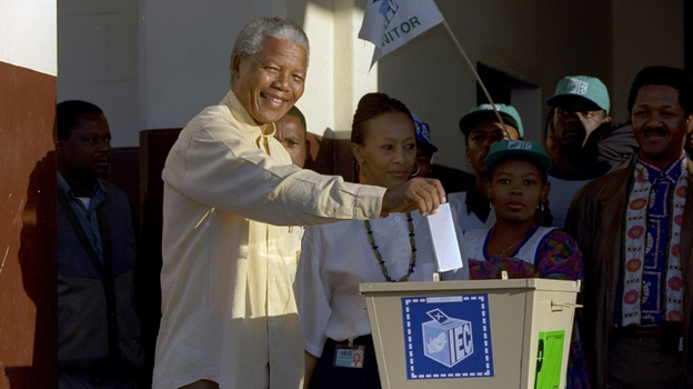Nelson Mandela casts his vote during South Africa's first all-race elections in 1994. Mandela's example led to more democracy across Africa, although overall political freedom has declined on the continent in the last five years. (AP)