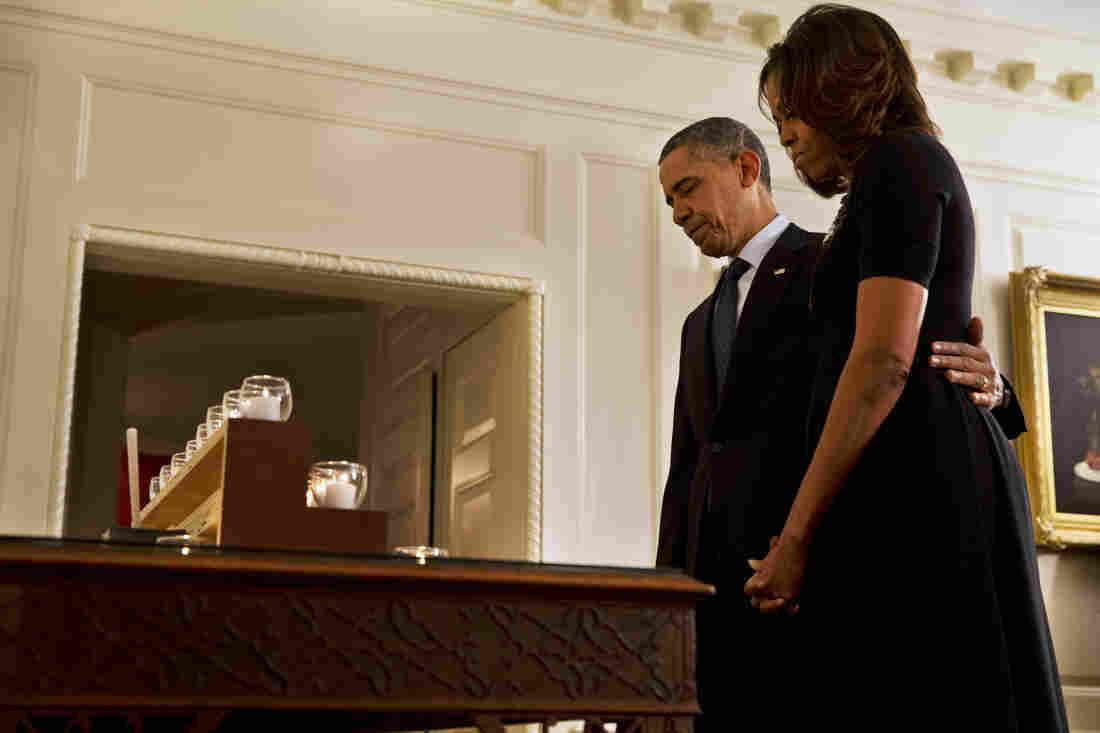 President Obama and first lady Michelle Obama take a moment of silence in honor of the Newtown shooting victims on the one year anniversary of the tragedy.