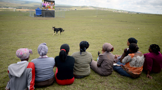 Large video screens were set up around the village of Qunu for the more than 4,000 mourners who gathered for the service. (Getty Images)