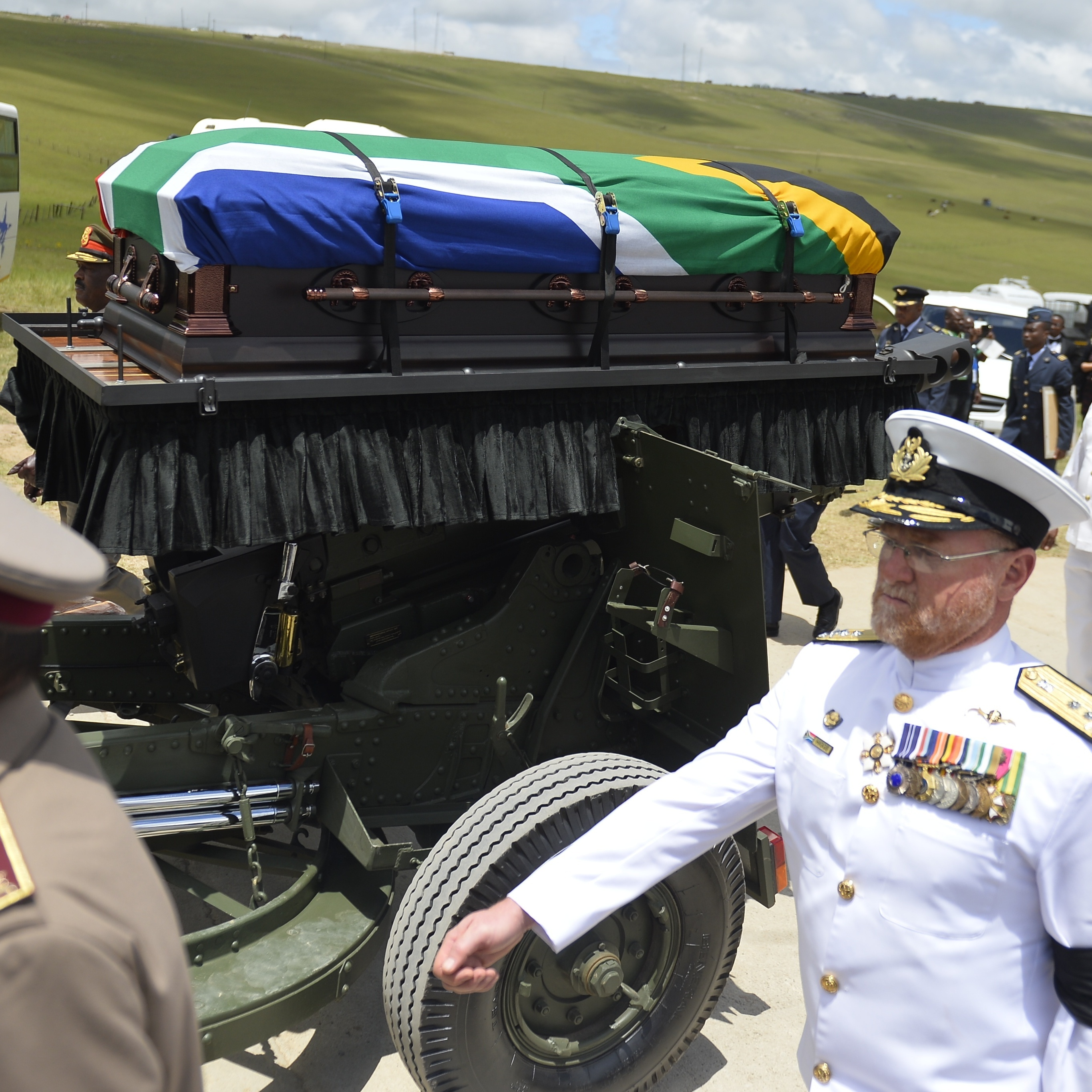 The coffin of South African former president Nelson Mandela is brought on a gun carriage for a traditional burial during his funeral in Qunu on Sunday.