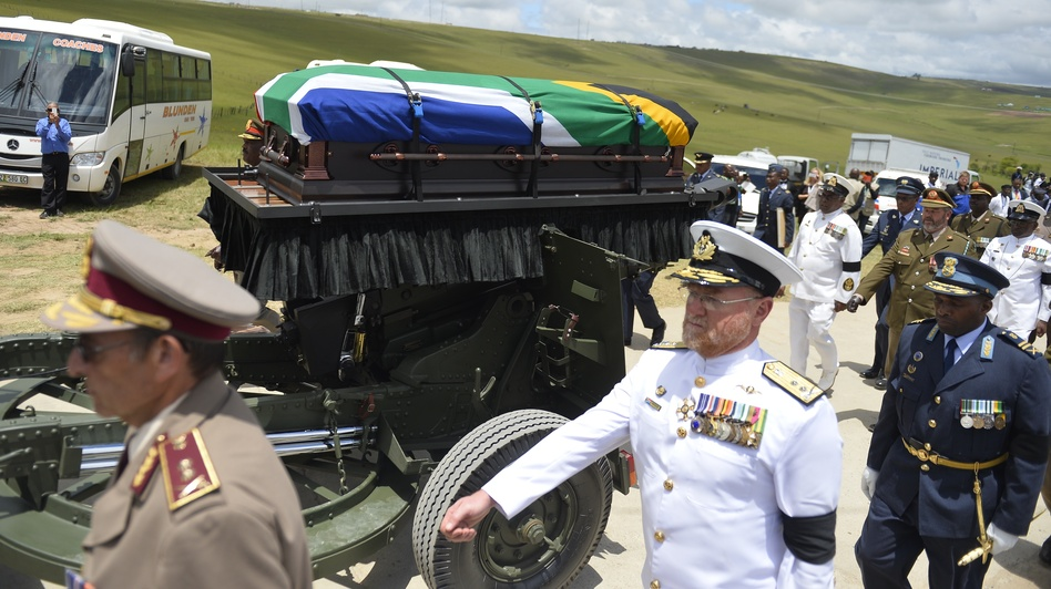 The coffin of South African former president Nelson Mandela is brought on a gun carriage for a traditional burial during his funeral in Qunu on Sunday. (AFP/Getty Images)