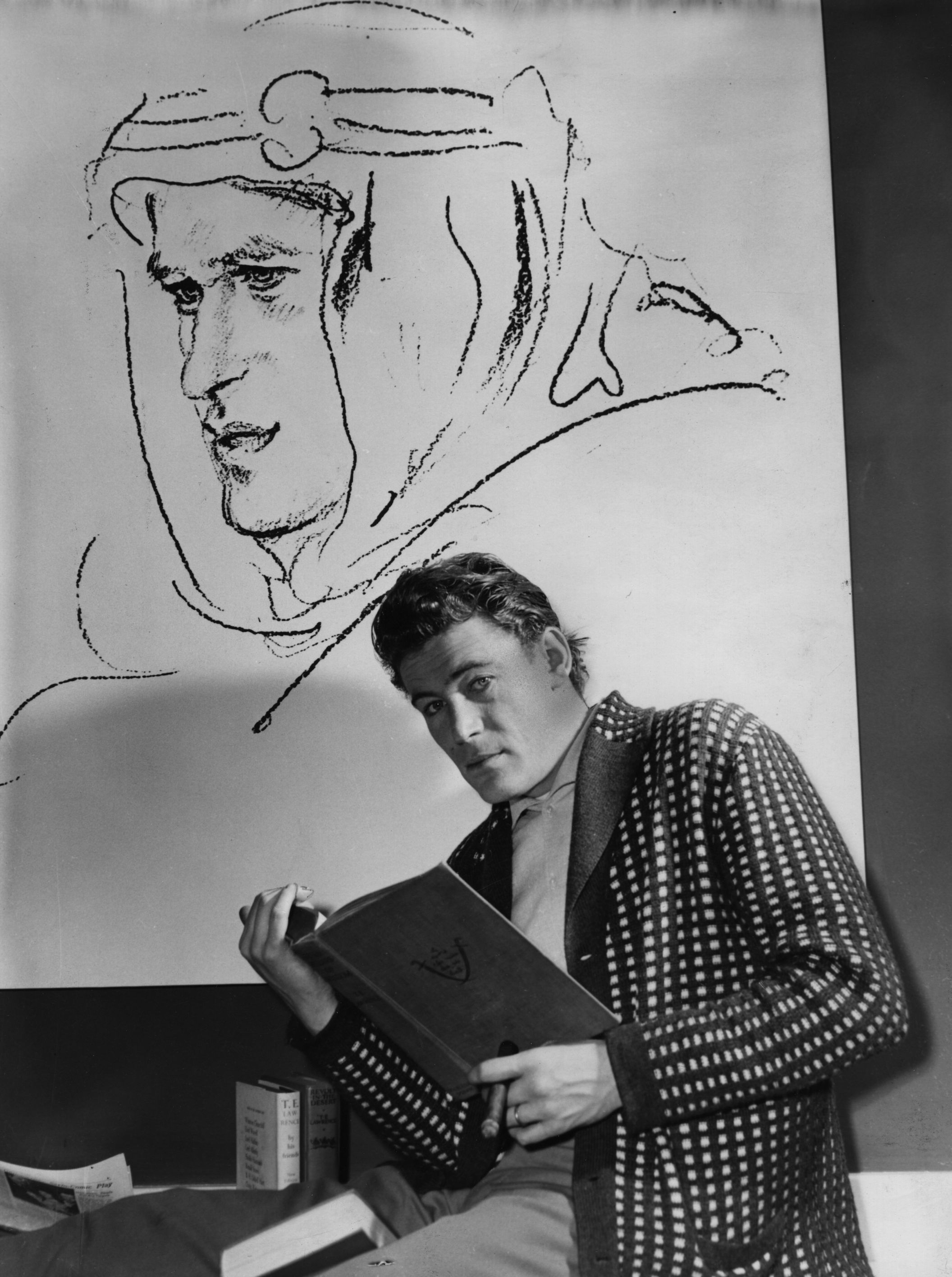 "O'Toole studies for his role in Lawrence of Arabia. ""I can't imagine anyone whom I'm less like than T.E. Lawrence,"" O'Toole told Fresh Air's Terry Gross in 1993."