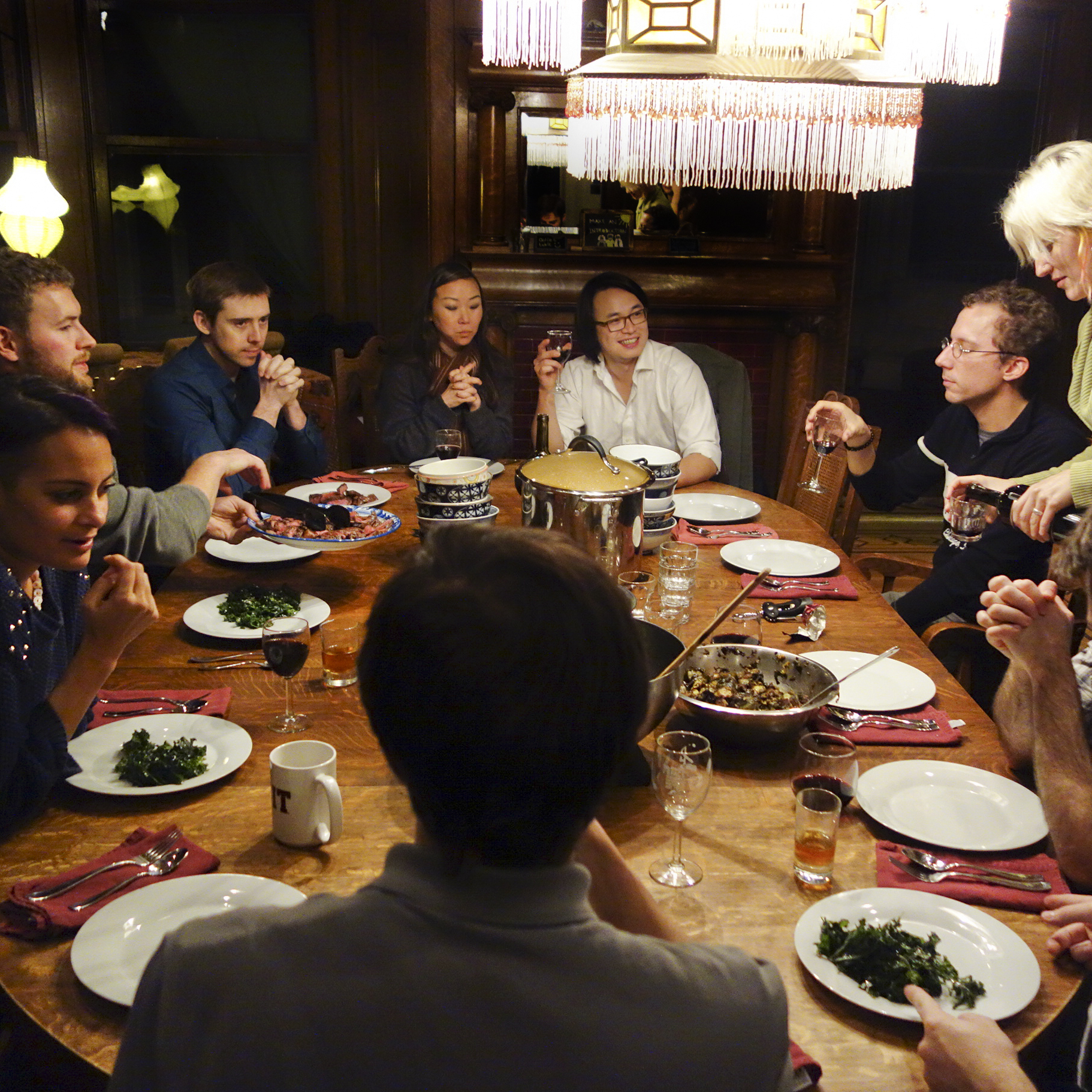 Residents of the Embassy House, a communal home near San Francisco's Haight-Ashbury district, eat dinner together every Sunday.