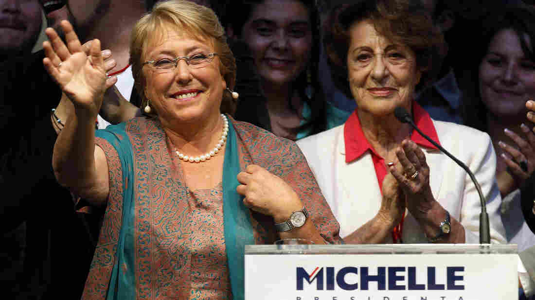 Presidential candidate Michelle Bachelet waves during a victory rally in Santiago, Chile, on Sunday. She defeated her conservative rival Evelyn Matthei with 62 percent of the vote.