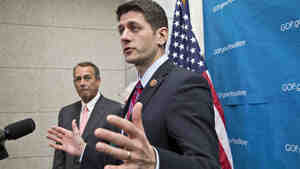 House Budget Committee Chairman Paul Ryan, R-Wis. (right), accompanied by House Speaker John Boehner of Ohio, tak