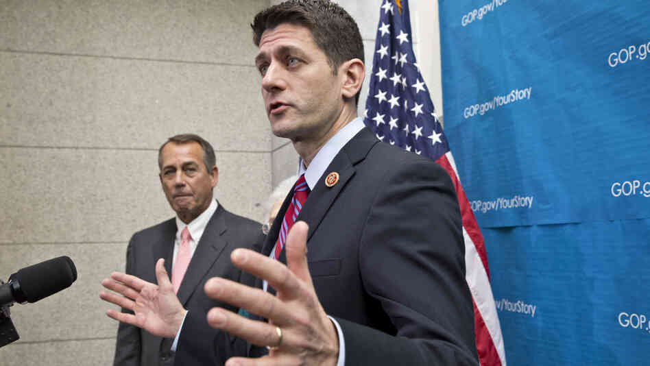 House Budget Committee Chairman Paul Ryan, R-Wis. (right), accompanied by House Speaker John Boehner of Ohio, takes reporters' questions during a Dec. 11 news conference.