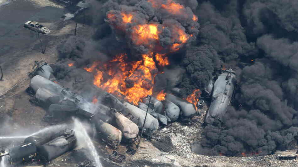 Scene of the disaster: On July 6, smoke rose from the tank cars that derailed in Lac Megantic, Quebec. The explosions and fires killed 47 people.