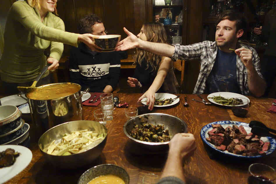 Housemates prepare a big meal and dine together every Sunday night, and sometimes more often