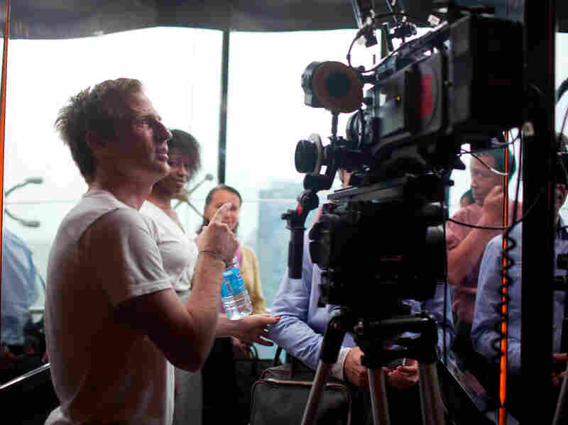 Jonze (above), says the film asks questions about love and relationships and technology rather than proposing answers to them.