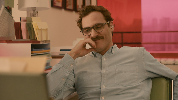 Joaquin Phoenix plays a man in love with an operating system in director Spike Jonze's latest film, Her. (Warner Bros.)