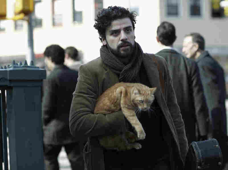 """An orange tabby cat co-stars alongside Oscar Isaac in the Coen brothers' Inside Llewyn Davis. """"The whole exercise of shooting a cat is pretty nightmarish because they don't care about anything,"""" Ethan Coen says."""