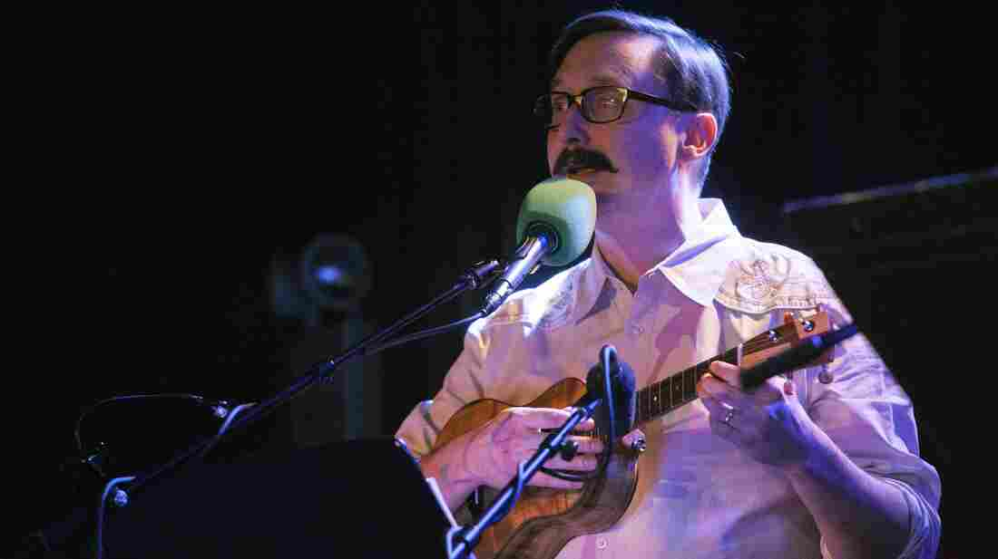 """Comedian John Hodgman helped lead a game, then picked up the ukulele for a rendition of """"Auld Lang Syne."""""""
