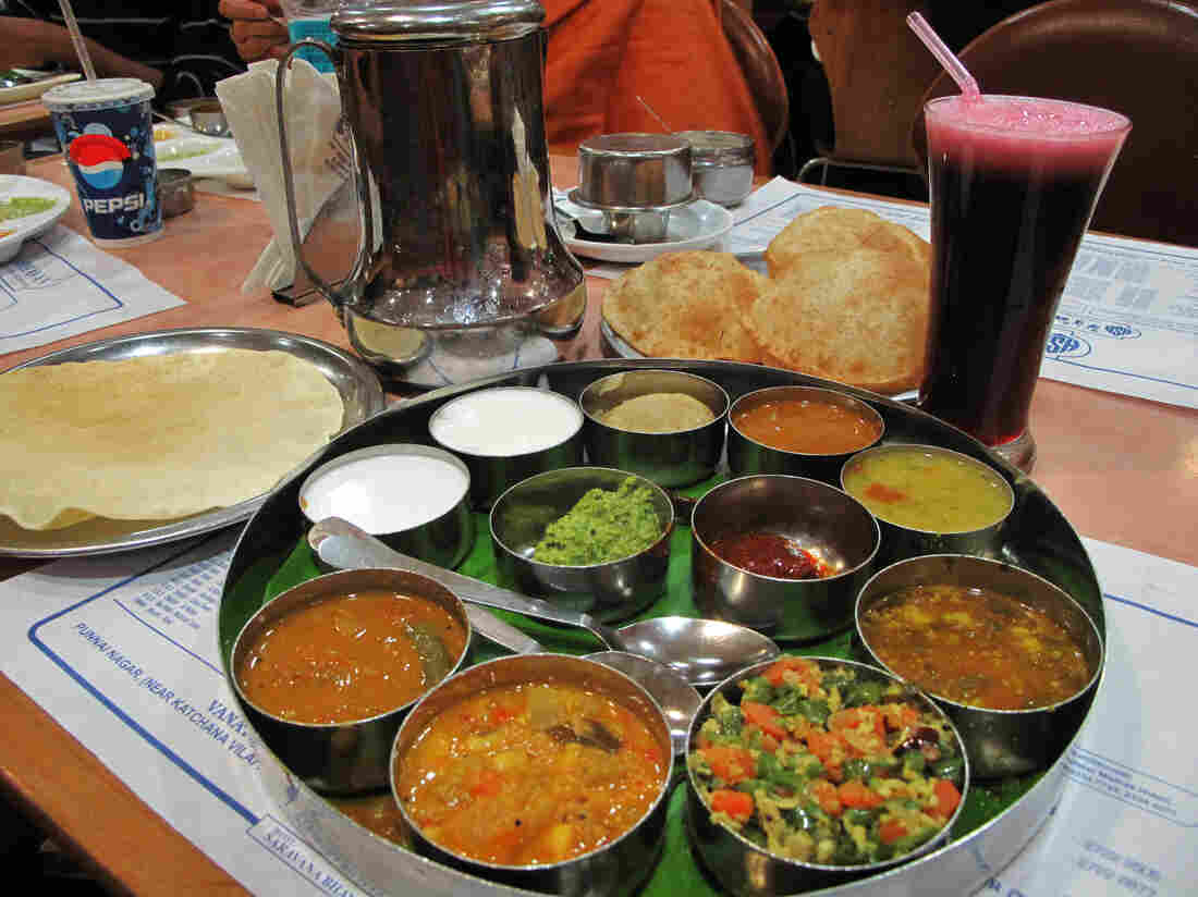 Date for two: Dinner includes a South Indian thali platter that typically includes dal, vegetables, roti, rice, curd (yogurt) and chutney served in small bowls, or katori, on a round tray. Throw in an order of delicious samosas.