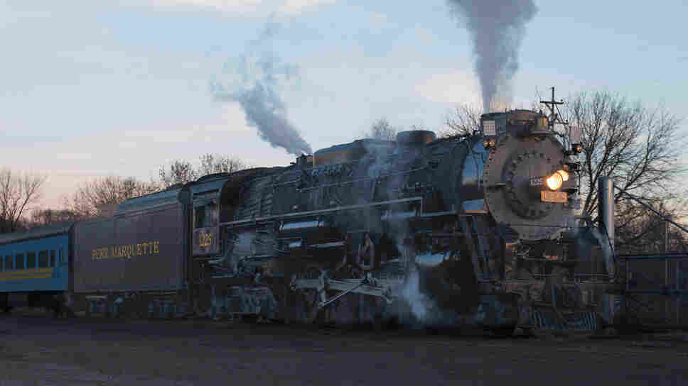 The Pere Marquette 1225 rolls into view in Owosso, Mich. It's been a local favorite for decades and especially gained popularity after inspiring the look and sounds of the train in a 2004 film.