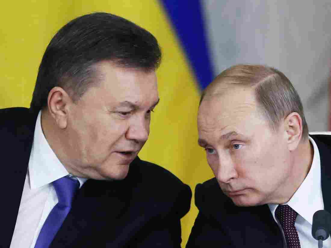 Russian President Vladimir Putin (right) listens to Ukrainian President Viktor Yanukovych in the Grand Kremlin Palace in Moscow, Russia, on Tuesday.